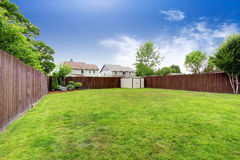 Spacious fenced backyard with shed Royalty Free Stock Photo