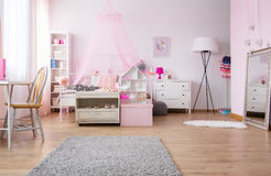 Spacious girl bedroom in pink Royalty Free Stock Photography