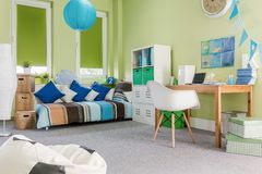 Spacious green boy room Stock Photos