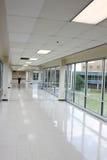 Spacious hallway. Spacious long hallway with large windows Royalty Free Stock Image