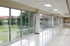 Spacious hallway. Spacious empty hallway with large windows Royalty Free Stock Photography