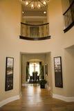 Spacious hallway. Luxury home hallway with a hardwood floor Royalty Free Stock Photography