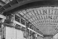 Spacious hangar area with crane. stock photos