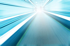 Spacious  high-speed moving escalator Royalty Free Stock Images