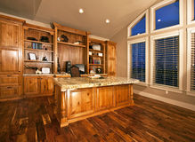 Spacious home office with wood floors Stock Photo