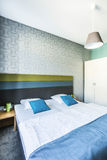 Spacious hotel bedroom with twin bed Royalty Free Stock Images