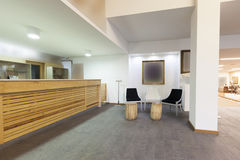 Spacious hotel lobby with reception desk.  Stock Photos