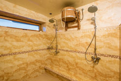 Spacious interior of empty bathroom with marble tiles Royalty Free Stock Images
