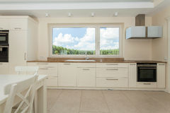 Spacious kitchen in modern house Royalty Free Stock Image