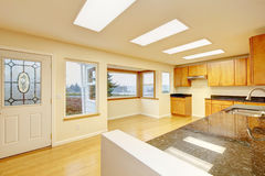 Spacious kitchen room with skylights and black granite tops. Royalty Free Stock Images