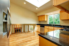 Spacious kitchen room with window in ceiling Royalty Free Stock Photography