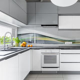 Spacious kitchen with window. Functional and spacious kitchen with window, furniture in white and grey Stock Images