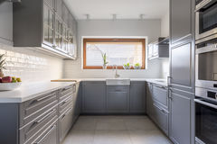 Spacious kitchen with window. Light, spacious kitchen with window and white brick tiles Royalty Free Stock Image