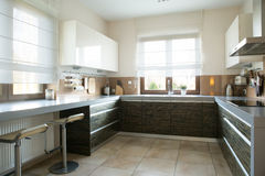 Spacious kitchen with window. In modern apartment stock images