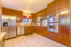 Spacious Kitchen With Plenty Of Amenities, Square Tile Floor And Stock Photography