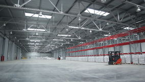 Spacious  Light Warehouse with Cargo Machines stock video footage