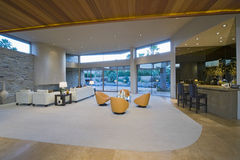 Spacious Living Room By Bar Area Against Porch Stock Photo
