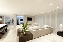 Spacious living room with grey sofas Stock Photos