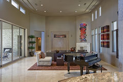 Spacious Living Room With Piano In Foreground Stock Photo