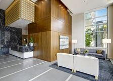Spacious lobby area in a modern luxurious condominium. Stock Image