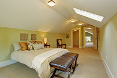 Spacious  master bedroom with vaulted ceiling and skylight Stock Photos