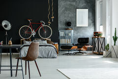 Spacious modern bedroom. Spacious modern designed bedroom in black and grey colors Stock Photos