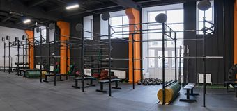 Modern interior of the gym for fitness training with horizontal bar and barbells Royalty Free Stock Photography