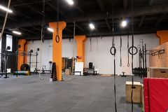 Spacious modern interior of gym for fitness training Royalty Free Stock Photos