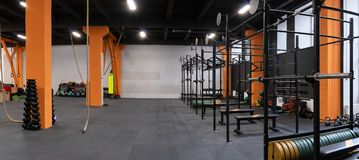 Spacious modern interior of the gym for fitness workout Stock Photo
