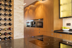 Spacious modern kitchen. With wooden units and space for wine stock image