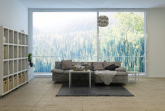 Spacious modern living room overlooking a forest Stock Photos