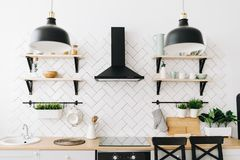 Spacious modern Scandinavian loft kitchen with white tiles and black appliances. Bright room. Modern interior. stock photos