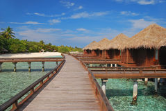 Spacious Overwater Bungalow with Long Wooden walkway Stock Images