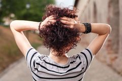 Spacious rear view of a girl with red curly hair Royalty Free Stock Image