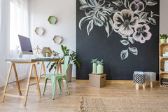 Spacious room with desk. Chair and decorative chalkboard wall Stock Images