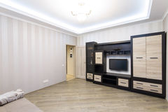 Spacious room with furniture, large closet and TV Stock Images