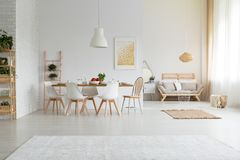 Spacious and simple dining room. With modern furniture Stock Photography