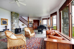 Spacious stone living room with piano Stock Photography