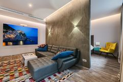 Spacious studio apartment interior. With big photo on wall stock photography