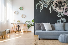 Spacious studio apartment. Modern spacious studio apartment with sofa and desk Stock Photos