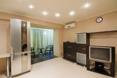 Spacious studio apartment with an open balcony Royalty Free Stock Photo