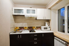 Spacious studio apartment, view of the kitchen stock photos