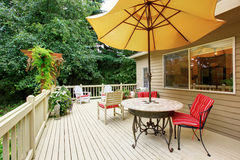 Spacious walkout deck with patio area Stock Images