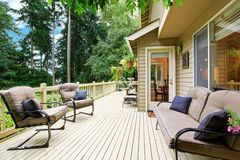 Spacious walkout deck with sitting area Stock Photos