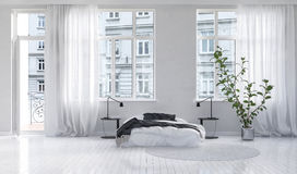 Spacious white bedroom with balcony Royalty Free Stock Photo