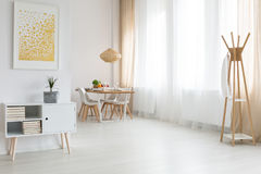Loft with dining room. Spacious white loft with elegant nordic dining room Royalty Free Stock Photography