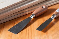 Spackle knives on a wooden table. Two spackle knives on a wooden work table Stock Image