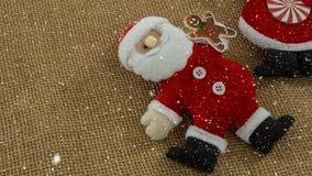 Spada śnieg z Bożenarodzeniową Santa dekoracją zbiory