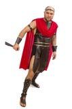 Spada della tenuta del gladiatore isolata su bianco Fotografie Stock