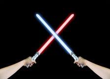 Spada laser rossa e blu immagini stock libere da diritti
